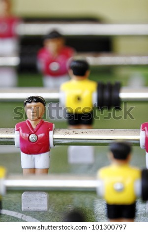 Closeup of colorful foosball mini figurine. - stock photo