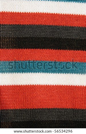 closeup of colorful striped fabric with red blue white and black stripe - stock photo