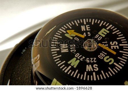 closeup of compass in the corner - stock photo