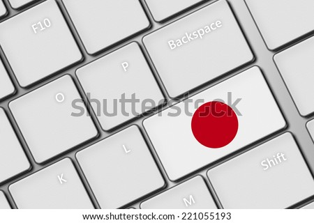 closeup of computer keyboard with Japan flag button - stock photo