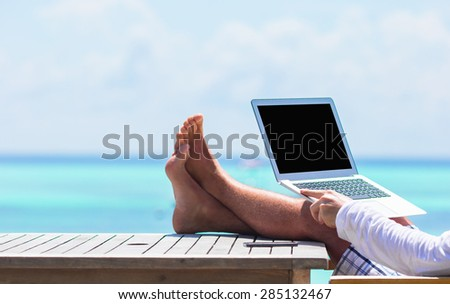 Closeup of computer on table background the sea - stock photo