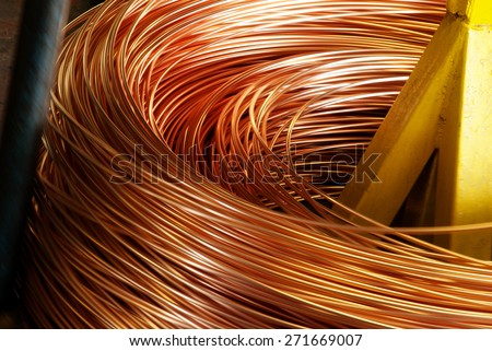 Closeup of Copper Cable being Rolled up in Preparation for Shipment at the Factory - stock photo