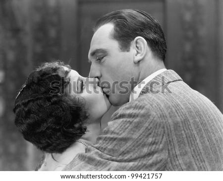 Closeup of couple kissing - stock photo