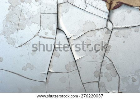 Closeup of cracked and peeling paint on an old car - stock photo