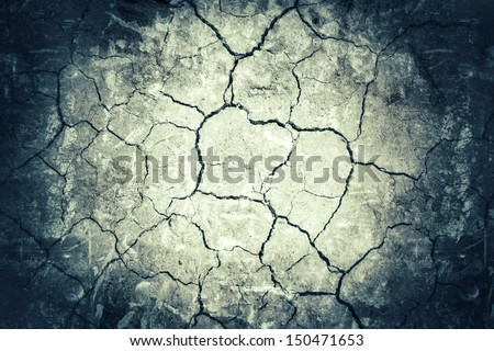 Closeup of cracked dry soil - stock photo