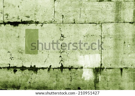 Closeup of cracks in green wall - stock photo