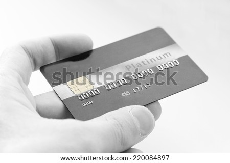 closeup of  credit card holded by hand. Black and white picture - stock photo
