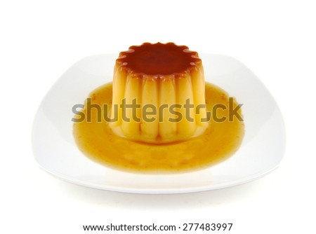 Closeup of creme caramel, caramel custard or custard pudding isolated on white background - stock photo