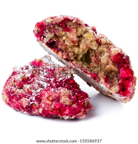 Closeup of crumbled cookie with oatmeal and raspberry on white background. Healthy lifestyle concept  - stock photo