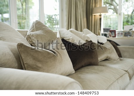 Closeup of cushions on sofa in the living room at home - stock photo