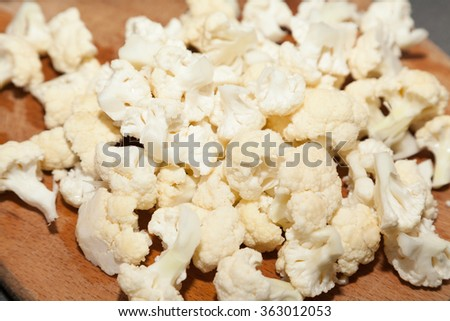 Closeup of cut white cauliflower with selective focus - stock photo