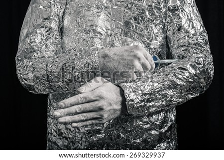 Closeup of cyborg fixing himself with screwdriver. - stock photo