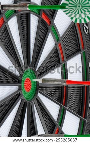 Closeup of dart board with darts. - stock photo