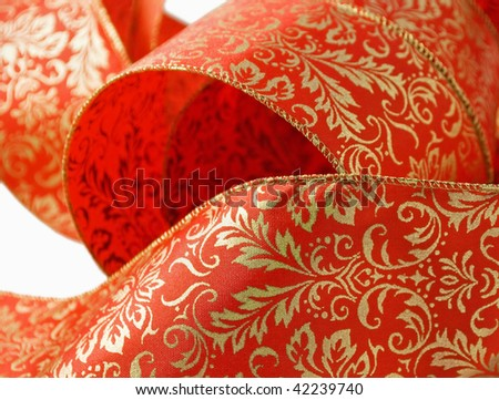 closeup of decorative curled red and gold ribbon - stock photo