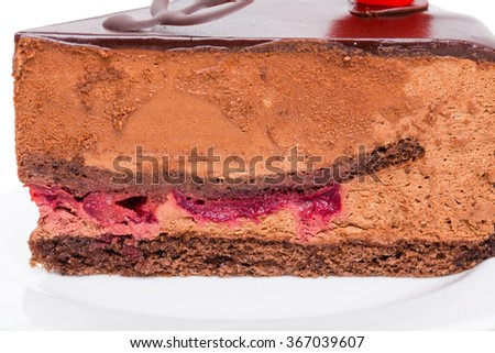 Closeup of delicious chocolate cake with cherry. Macro. Photo can be used as a whole background. - stock photo
