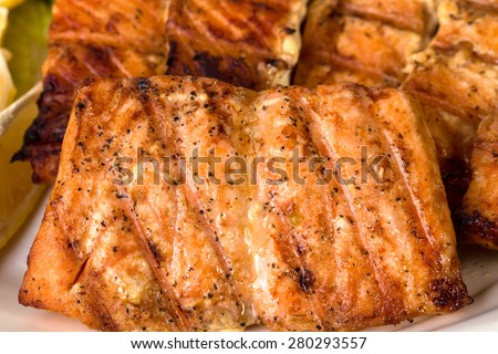 Closeup of delicious grilled salmon fillet. Macro. Can be used as a whole background. - stock photo
