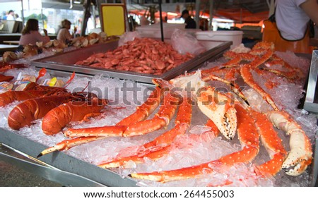 Closeup of delicious lobsters, crabs and king crabs in Bergen fish market, Norway - stock photo