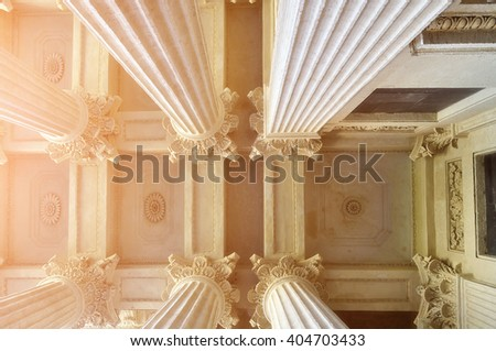 Closeup of details of Kazan Cathedral colonnade and ceiling lit by soft sunshine in Saint-Petersburg, Russia. Lowest point of shooting.  - stock photo