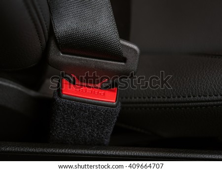 Closeup of details of the car safety or seat belt with PRESS inscription - stock photo