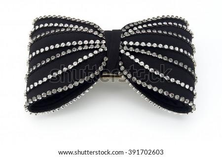 Closeup of diamond bow tie on white background - stock photo