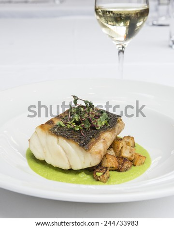Closeup of Dinner Plate with Grilled White Fish and potatoes  - stock photo