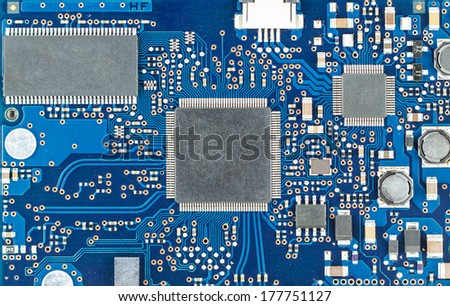 Closeup of dirty electronic circuit board - stock photo