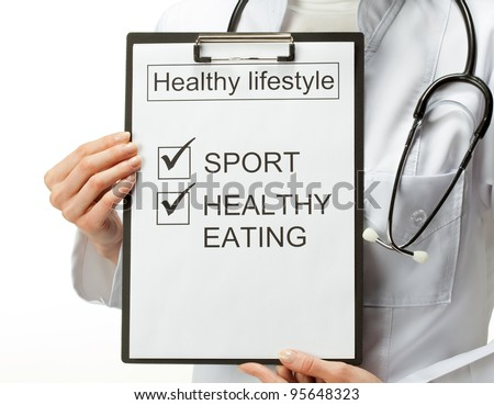 Closeup of doctor's hands holding clipboard with marked checkboxes which are basis of healthy lifestyle; healthy lifestyle concept; isolated on white background - stock photo