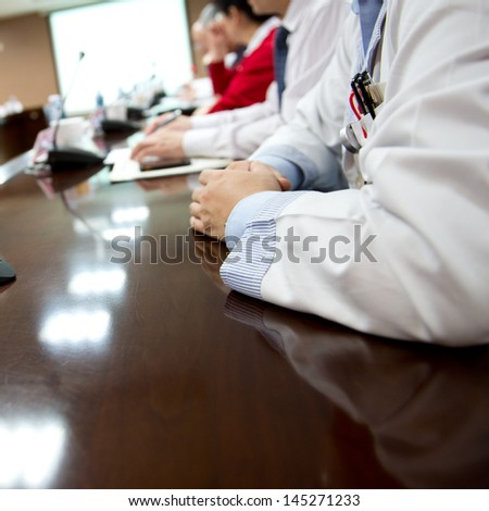 Closeup of doctors at medical conference.  - stock photo