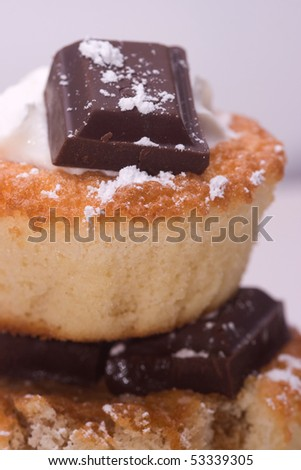 Closeup of double chocolate and coffee cupcake with cream - stock photo
