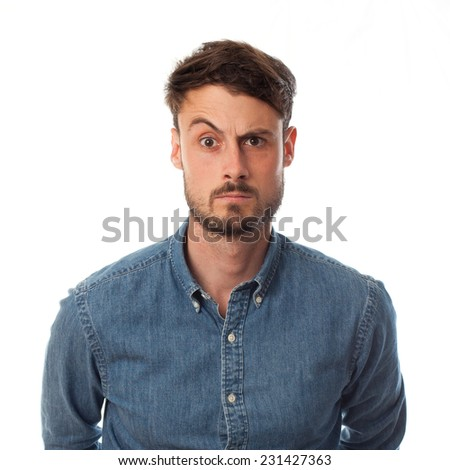 closeup of doubt young cool man - stock photo