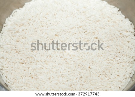 Closeup of dry basmati rice with selective focus - stock photo