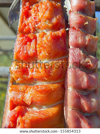 Closeup of Drying Salmon on Sticks by Native Americans in Alaska - stock photo
