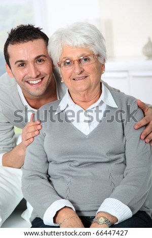Closeup of elderly woman with young man - stock photo
