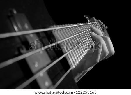 closeup of electrical guitar fingerboard, black and white - stock photo