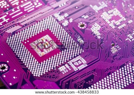 Closeup of electronic circuit board. - stock photo