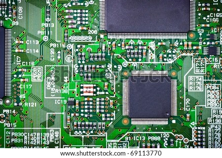 Closeup of electronic circuit board - stock photo