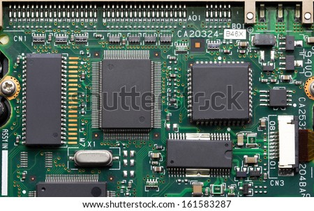 Closeup of electronic circuit board with processor - stock photo