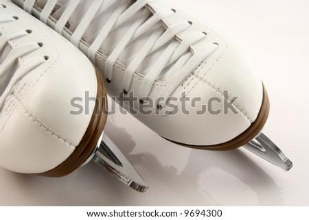 Closeup of elegant white figure skates. - stock photo