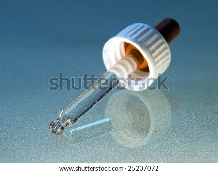 Closeup of eyedropper, usable for research, science  and medical theme. - stock photo