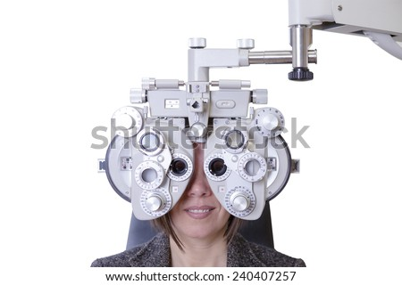 closeup of eyesight measurement to a young woman with a optical phoropter - focus on the phoropter center - stock photo