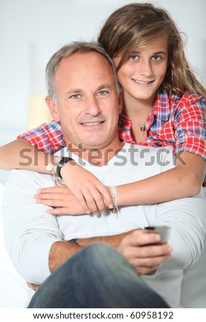 Closeup of father and daughter at home - stock photo