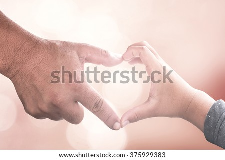 Closeup of father and son making heart shape with hands. Unity, Adam, Cancer, CSR, Kid, Child, Boy, Two, Help, Trust, Life, Dad, People, Parent, Peace, Grace, Donor. - stock photo