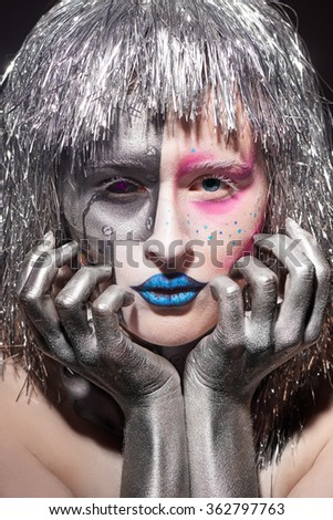 Closeup of female face with bright makeup. beautiful woman with silver hair and hands - stock photo