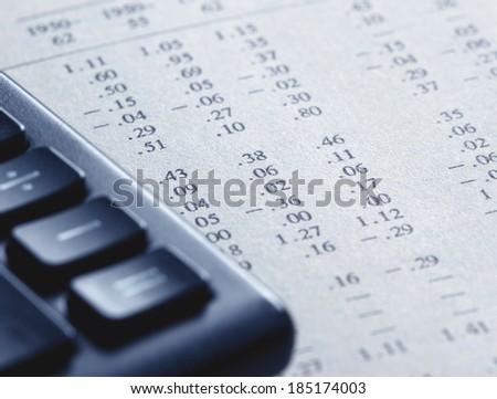 Closeup of financial figures, tinted photo - stock photo