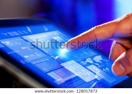 Closeup of finger touching blue toned screen on tablet-pc - stock photo