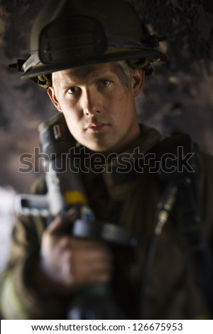 Closeup of fire fighter at work - stock photo