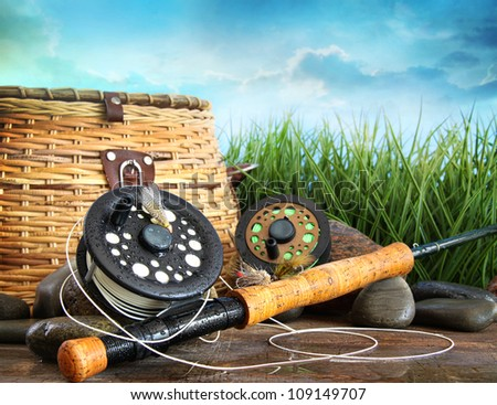 Closeup of fly fishing equipment and basket - stock photo