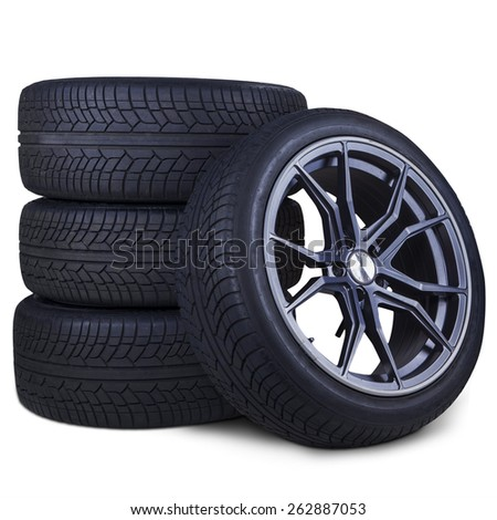 Closeup of four tires with racing rim and black texture, isolated over white background - stock photo