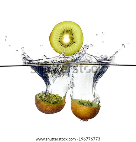 Closeup of fresh and health kiwis falling into clear water isolated on white background. - stock photo