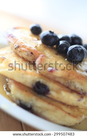 Closeup of fresh blueberry pancakes with syrup - stock photo